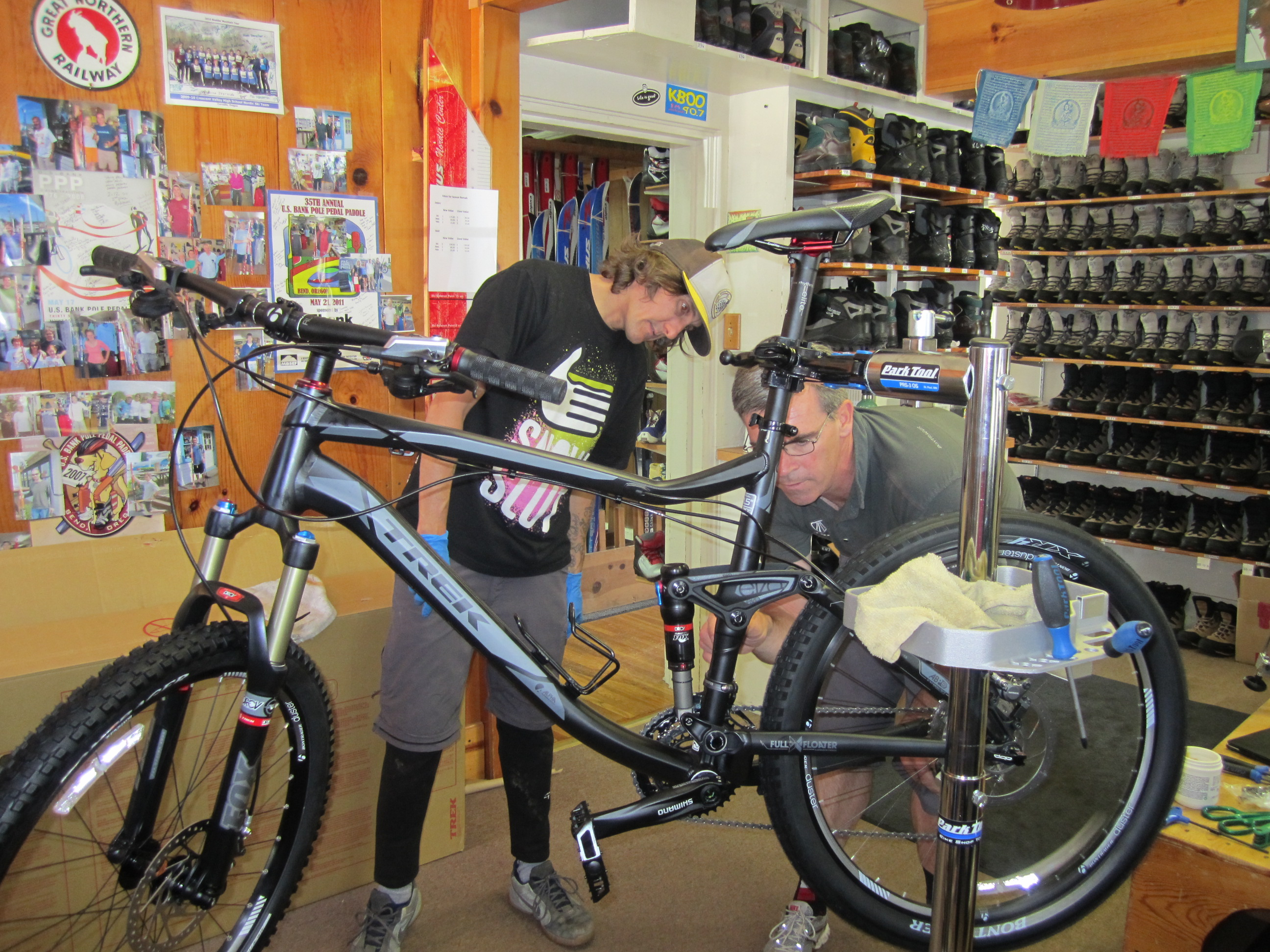 Toby, the Trek Rep and Dan assembling bikes